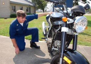 Man Inspecting used motorcycle